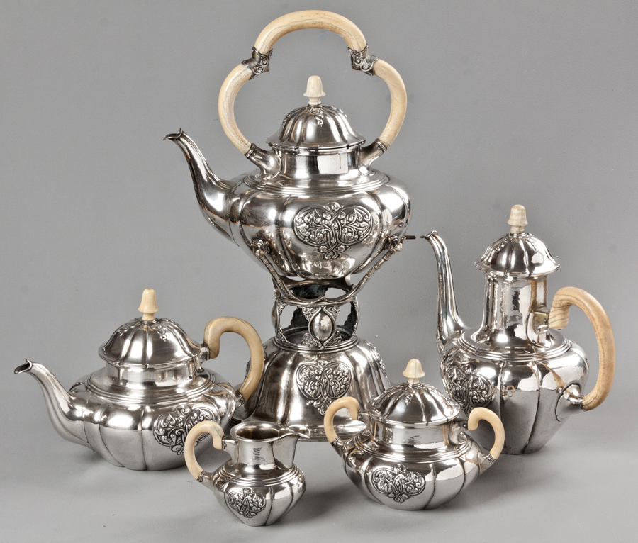 A DUTCH .835STD SILVER OVAL FORM TEA CADDY, The Hinged Top With Flame Form Finial, The Entire Piece