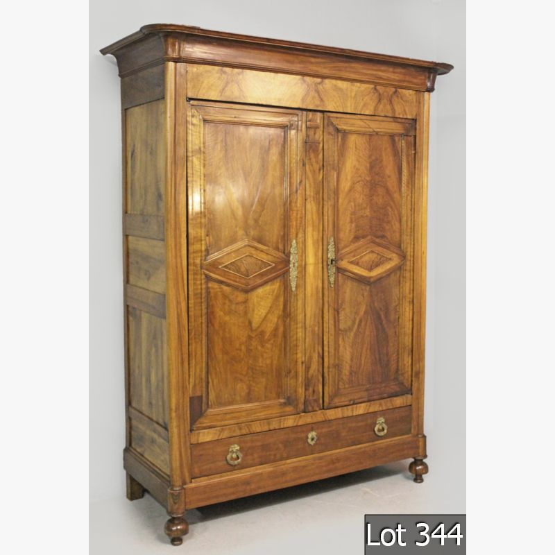 Lot 344 – A MID-19th CENTURY FRENCH WALNUT ARMOIRE